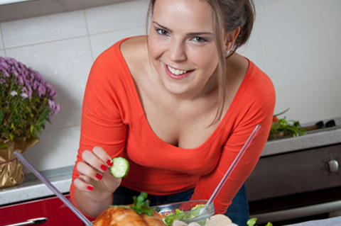 bistro-md-woman-excited-eating-salad-and-chicken