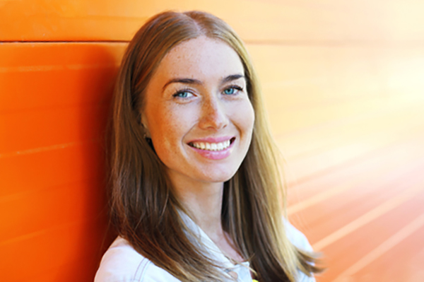 Happy Woman with Orange Background